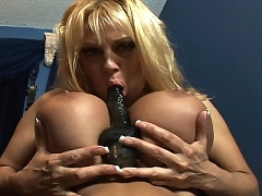 Harmony plays with her huge tits