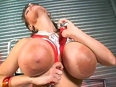 Cindy Cupps strangles her tits with suspenders